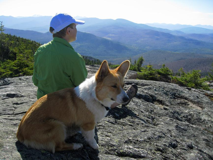 A hiker and her four-legged pal enjoy the views near the top of Caribou Mountain in Maine.